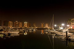 The Pearl- Reflections (aliffc3) Tags: thepearl qatar sonyrx100iv lowlightphotography nightshot water boats reflections middleeast handheld