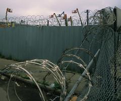 NY Streetscapes 711 (stevensiegel260) Tags: newyork brooklyn bushwick fence barbedwire industrial cranes