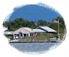 June Moon. West Island. (BruceLorenz) Tags: june moon west island ifre long ny new york great south bay little pink house houses steven leslie schwan american flag