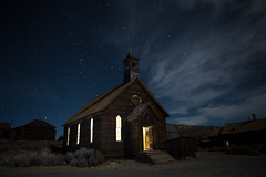 """Goodbye God, I'm going to Bodie."" (Miss.Rachel) Tags: goodbyegodimgoingtobodie bodie ca california methodist church nightshots nightphotography ghost town stars clouds light from within ghostly"