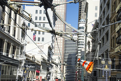 Cone in the catenary (railfan3) Tags: sanfrancisco trolleybus muni overheadwires catenary cone block detail california american america traffic suspended troleybus blockage highup safetycones witchshat usa