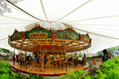 The Carousel (Renee Rendler-Kaplan) Tags: fisheye fisheyelens nikon nikond80 outside outdoors zoo lincolnparkzoo lincolnpark tent peoplestanding people peoplesitting greenery reneerendlerkaplan september 2016 colorful chicagoist chicagoreader consumerist wbez sit sitting seated