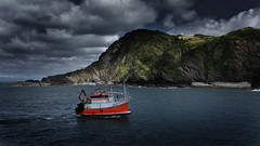 Haven bound (Matt West) Tags: boat trawler ship sea fisherman ocean cove bay port haven harbor harbour sky cliffs ilfracombe beach clouds orange dramatic