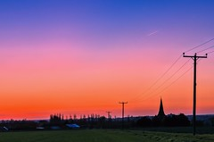 Rural England (Jez22) Tags: uk blue trees sunset england sky copyright plant color building green english church colors field parish yellow skyline rural dark landscape outdoors evening countryside early kent twilight glow colours exterior village view dusk farm country scenic nobody landmark scene rape steeple pole spire crop environment southeast agriculture vane telegraph tranquil sillhouette hamlet rapeseed oilseed jeremysage