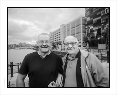 Tom Walsh BEM, with his nephew. (Gary Rowlands) Tags: hasselblad 50mm fle pentax67 fuji acros100 hc110 salfordquays britishempiremedal bem portrait bw monochrome film male oap zeiss distagon f40 spectacles manchester faces 848 imacon scanner street stranger mf mediumformat analogue silver cfi