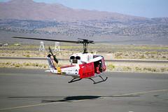 "HH-1N ""Huey"" 158557 at Reno, 1999 (Ian E. Abbott) Tags: bellhh1niroquois bellh1niroquois bellhh1n bellh1n bellh1 hh1niroquois h1niroquois h1iroquois hh1nhuey h1nhuey bell hh1n h1n h1 iroquois huey twinhuey 158557 rescuehuey rescuehelicopter helicopter 1999renoairraces renosteadairport krts rts scanned35mmcolornegative scanned35mmnegative scannedcolornegative colornegative film nikonfm nikonfilmcameras"