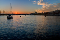 Uprising (ByronF) Tags: sanfrancisco sunrise boat water skyline cityscape city clouds sky blue sun pyramid baybridge coittower