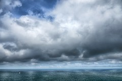 Small boat on a vast ocean (marko.erman) Tags: ocean atlantic normandy normandie france sony water immense vast lost boat clouds horizon panorama seascape