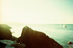 Are You Where You Want To Be? (thomas_anthony__) Tags: camera canon a1 film fuji velvia 50 water sea ocean 35mm analog sun sunset horizon sky beach rock rocks boat boats ships xpro