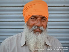 2014-10a Seeking Sikhs in Rajasthan (01) (Matt Hahnewald) Tags: facingtheworld photography photo image outstanding fantastic favourite superior excellent interesting nikond3100 nikkorafs50mmf18g primelens 50mm 43aspectratio horizontalformat closeup portrait portraiture streetportrait headshot enface outdoor colour character personality realpeople individual human humanhead humanface humaneyes facialexpression grinning eyecontact strong manly proud authentic fullbeard sikhbeard sikhdastar turban consent empathy rapport respect encounter fun environmentalportrait ethnicportrait travelportrait sikhism sikhman tradition bikaner rajasthan india ethnic oneperson male adult posing handsome powerful friend orangeturban whitebeard matthahnewaldphotography orange
