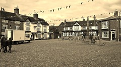The Saxon Crosses on the Cobbles in Sandbach in Sepia (Eddie Crutchley) Tags: england europe cheshire sandbach markettown historicbuilding halftimberedhouse cobbles saxoncrosses outdoor pub sepia simplysuperb