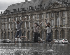 jumping (Artbywigs) Tags: france three bordeaux jump people action water building traffic wigs leaping