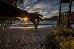 Catching the giant (Vagelis Pikoulas) Tags: sun sunset sunburst sunshine man beach sea seascape canon landscape view sky clouds cloud cloudy 6d tokina 2016 october autumn porto germeno greece europe