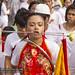 Girl at street procession at Phuket Vegetarian Festival. October, 2016. Phuket, Thailand