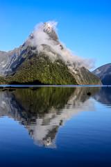 Mitre Peak (robertdownie) Tags: mist fog morning reflection blue new zealand mountain cloud peak clear sound south island fjord refelction maori crisp milford mitre nz piopiotahi te wahipounamu rahotu