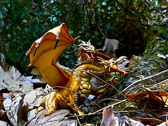 golden dragon nest (bbrightmanphotography) Tags: dragon twoheadeddragon trees leaves forest dragonnest mysticalcreatures childrenstoys illustrationeffect fantasy