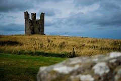 Dunstanburgh (michael.imber) Tags: dunstanburgh cloudy tower field landscape moody brooding ruin north east england beginner