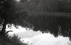 Riverrun (Magnus Bergstrm) Tags: canonae1 canon ae1 analog bw blackwhite blackandwhite kodak kodaktmax100 kodaktmax tmy 100tmx sweden sverige karlstad vrmland river klarlven runner jogging mirror