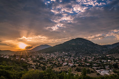 Sunset in my hometown (Vagelis Pikoulas) Tags: sun sunset sunburst sunshine sunrays vilia village greece europe autumn september 2016 canon 6d tokina 2470mm view landscape sky clouds cloud cloudy house houses green golden blue