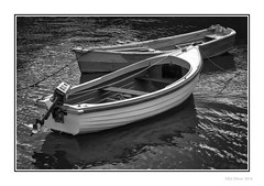 Moored (Seven_Wishes) Tags: newcastleupontynenortheast photoborder canonef24105mmf4lis canoneos1dmarkiv amble coastal boats moored water blackandwhitr monocchrome mono reflections hh wooden outboard ripples newcastleupontyne tyneandwear uk