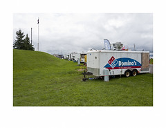 Domino's The Pizza Delivery Experts (Richard C. Johnson: AKA fishwrapcomix) Tags: leicaq summilux28mm f17 paxamericanus digital chisolm minnesota countyfair endofsummer endofempire midwest duluth ironrange civisromanussum wetzlarmojo deutschemagic reddot carnival clouds flag grass approachingstorm trailers