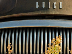 B U I C K (Nicolas) Tags: vieille rouille route66 vacances ruine pave ancienne grille collection voiture ombre lumire shadow light america grants newmexico nicolasthomas usa abandoned buick car decay holidays old ruin rust vintage chrome lines curves radiator collectible travel voyage transport transportation