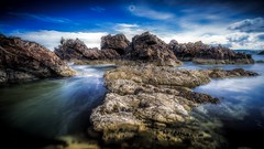 Pile Up (Augmented Reality Images (Getty Contributor)) Tags: barnacles bigstopper bluesky canon coastline cullen landscape leefilters longexposure morayshire rocks scotland seascape summer water