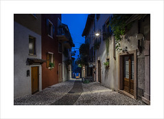 Malcesine Streets III (andyrousephotography) Tags: italy lakegarda malcesine postcard image town oldtown oldeworlde streets tourists tourism shops bars restaurants locals deserted quite dawn morning bluehour andyrouse canon eos 5d mkiii