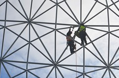 Hot orange and cool green... repairing Montreal geodesic dome (jungle mama) Tags: geodesic dome bucky buckminsterfuller spaceshipearth montreal biosphere repair
