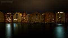 Like Houses in a Chain  (Explored) (Normann Photography) Tags: likehousesinachain nidelven trondheim architecture buildings decayed longexposure nightphotography reflections river sortrondelag kingdomofnorway no visitnorway decay line row stream