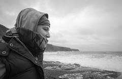 Auchmithie (B Hutchison) Tags: xt1 scotland beach auchmithie stones waves wind weather cold cliffs bw scarf