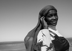 Sudanese Teenager Girl, Meroe, Sudan (Eric Lafforgue) Tags: africa portrait blackandwhite smiling horizontal outdoors photography day veiled veil northafrica soedan sudan teenager copyspace nubia oneperson soudan saharadesert northernafrica meroe realpeople traveldestinations blackskin onewomanonly lookingatcamera headandshoulder  1people szudn sudo  northernsudan 1415years northsudan      xuan eri8290