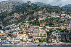 Amalfi Coast (roevin | Urban Capture) Tags: positano campania italy it city old buildings church cathedral street streets sprawl hill mountain hills panorama overview stairs uphill tree trees window facade construction coast sea mediterranean beach houses harbor sun clouds cliff cliffs