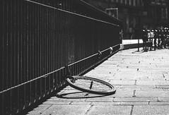Loneliness (Lasorigin) Tags: centreville noirblanc rue strasbourg street urbanpicture vlo bike bw blackwhite steel pavment curve sunlight shadow canon eos 100d 50mm lightroom stone pierre graphic graphique