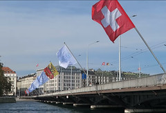 Suisse flag (Dedorru) Tags: suisse swiss switzerland drapeau flag buildings lakegeneva lake bridge swisera