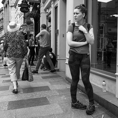 Knock Knees (Howie Mudge LRPS) Tags: woman people men women candid casual portrait stand standing shops windows pavement busy street streetphotography streetlife urban urbanphotography blackandwhite blackwhite mono monochrome monochromatic cardiff caerdydd capital city wales cymru uk travel traveler traveling outside outdoors compactcamera