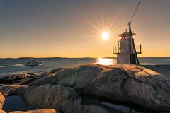 Fishing boat (johanbe) Tags: sunset solnedgng lighthouse fyr fishingboat boat fiskebt hav sea rocks klippor vstkusten gteborg hn skrgrd archipelago nikon d750 sigma sigma20mmf14art