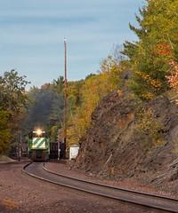 Throttle up (ilvchevs) Tags: train trains railroad track ge c307 lsi lakesuperiorishpeming rocks sky trees outdoor light smoke ore pellets autumn color