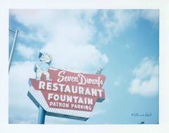 Seven Dwarfs Restaurant (ilovecoffeeyesido) Tags: polaroidcolorpackiiilandcamera polaroid fujifp100c analog film peelapartfilm illinois sooc fujifilm sevendwarfsrestaurant wheatonil vintagesign vintagesignage