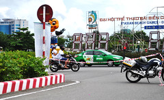 Not this way... (Roving I) Tags: traffic control motorbikes motorcycles ribbon tape block noentry intersections roundabouts danang vietnam cstt taxis beachgames signs cartoonfigures