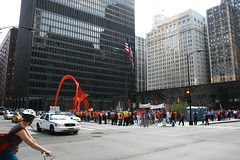 May Day (Flint Foto Factory) Tags: street plaza city urban sculpture chicago weather bike bicycle america john wednesday illinois spring workers warm downtown afternoon adams loop flag cab taxi flamingo may scene american calder rights bicyclist rushhour immigrants alexander mayday pm federal dearborn kluczynski 2013