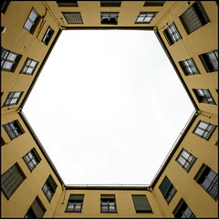 Hexagon (Maerten Prins) Tags: madrid windows sky white house yellow court spain symmetry hexagon six appartment spanje upshot hexa