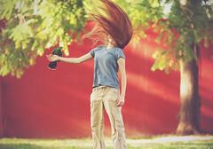 Her own private whirlwind (Proleshi) Tags: red woman bird girl hair longhair parrot naturallight josephs jamal worldwind 180mm hairtoss d300s proleshi goodbecauseithassoalotofvariety badbecausemystyleisallovertheplace imhappybecauseididverywellonmyelectriccircuitstest