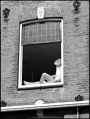 Funny window (Franco & Lia) Tags: street blackandwhite holland window amsterdam noiretblanc nederland finestra biancoenero blackdiamond photographiederue fotografiadistrada 2485f284