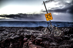 End of The Line (basselal) Tags: 100xthe2016edition 100x2016 image15100 lavarocks speedlimit hawaii bicycles clouds sign