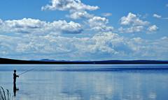 fisherman (lake ögii - arkhangai province - mongolia) (bloodybee) Tags: lake ögii arkhangai mongolia travel landscape water sky clouds reflection blue fish man people sil silhouette