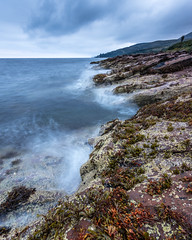 Sannox Shore (Tim Allott) Tags: barnacles shoreline sea sandstone longexposure waves seaweed coast rocks sannox arran firthofclyde isleofarran 2016 pentaxk3 scotland