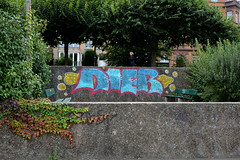 (urban) colours of autumn | Farben des Herbsts (rainbowcave) Tags: graffiti tag wall trees leaves benches bltter bank mauer mainz herbst autumn bume frau woman guesswheremainz