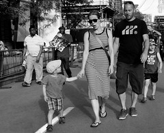 Sorry Sweetie, I Really Don't Know Why... (Szoki Adams) Tags: motherandchild montreal quartierdesspectacles justforlaughs2016 justepourrire2016 family children sunnyday sunglasses shadows expressions expressive chic summertime summerattire cap canong7xmarkii blackandwhite bw blackwhitephotos streetphotography streetphoto holdinghands outdoors father brother
