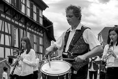 drummer and band (isobrown) Tags: marchin band fanfare harmonie drummer snare clarinette clarinet hindisheim alsace fte village france music musicien monochrome noiretblanc personnes artiste
